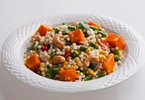 Pearl Couscous salad with vegetables and cashew nuts and a sesame dressing