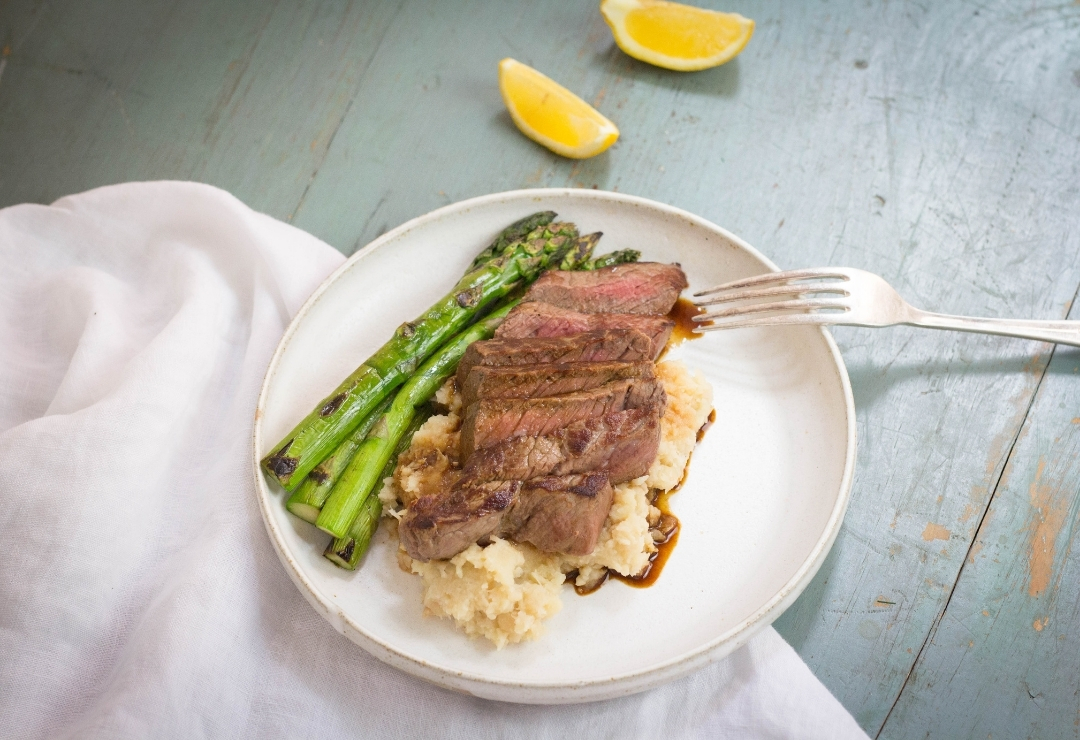 Grilled Steak on parsnip mash with charred asparagus